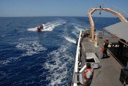 Small boat returning to the NOAA SHIP DAVID STARR JORDAN after marine mammal observation operations. Photo