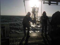 Oceanographer Steve Pierce and Survey Tech Lillian conducting CTD cast off the Miller Freeman 2005 NWFSC Acoustic Hake Survey. Photo