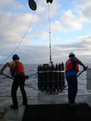 Johnny and Pedro recovering a CTD instrument and water sampling array. Photo