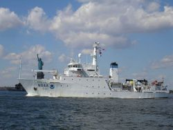 NOAA Ship THOMAS JEFFERSON in New York Harbor abreast of the Statue of Liberty. Photo