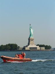 NOAA Ship THOMAS JEFFERSON RHIB underway off Statue of Liberty. Photo