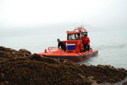 Rigid hull inflatable boat (RHIB) supporting tide gage operations. Photo