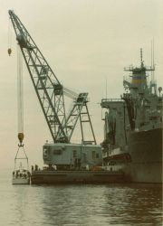 NOAA Launch 1257 alongside USNS cargo ship prior to transport and transfer to government of Malta Photo