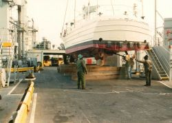 NOAA Launch 1257 being lowered to deck of USNS cargo ship prior to transport and transfer to government of Malta.This launch and its sister vessel Lau Photo