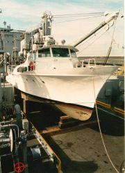 NOAA Launch 1257 cradled on the deck of USNS cargo ship prior to transport and transfer to government of Malta.This launch and its sister vessel Launc Photo