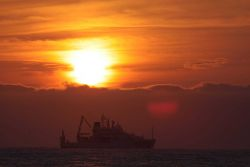 NOAA Ship PISCES silhouetted in the sunset Photo