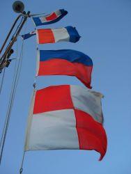 Call letter flags entering port - Whiskey Tango Echo Uniform of NOAA Ship KA'IMIMOANA. Photo