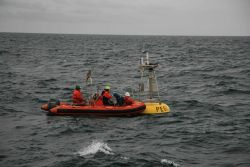 NOAA Ship MILLER FREEMAN rigid hull inflatable boat servicing the meteorological buoy designated PEGGY, named for Peggy Dyson, the voice of NOAA weath Photo