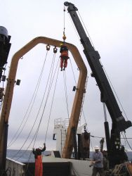 Performing maintenance on the running gear of the A-frame on the NOAA Ship MILLER FREEMAN. Photo
