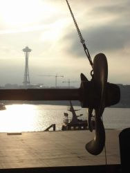 Propeller and shaft of NOAA Ship MILLER FREEMAN being worked on at Seattle shipyard with Space Needle in the background. Photo