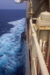 Working over the side on a bosun's chair on the SEALAND COMMITMENT somewhere in the Mediterranean. Photo