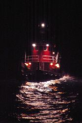 Tug boat on stormy seas at an oil platform site. Photo