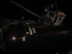 Fishing vessel tied up outboard of SS Coastal Nomad during ferocious winter storm Photo