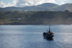 A fishing boat hailing from Valparaiso, 2000 miles away, anchored off Easter Island. Photo