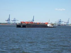 A tug and barge in Baltimore Harbor Photo