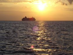 A cruise ship sailing into the sunset Photo