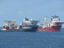 Deep ocean work vessels OLYMPIC CHALLENGER and BOA SUB C on-site at Deepwater Horizon well containment efforts. Photo