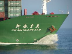 China Shipping Lines containership XIN QIN HUANG DAO. Photo
