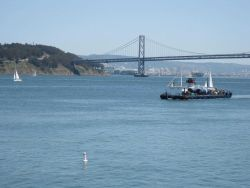 A self-propelled barge plying the waters of San Francisco Bay having just sailed under the Bay Bridge headed north. Photo