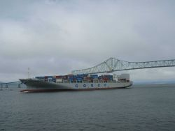 Cosco shipping lines COSCO ANTWERP heading out of the Columbia River just after passing under the Astoria Bridge. Photo