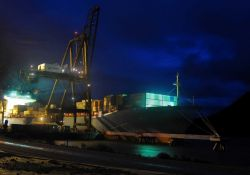 Containership working cargo at night. Photo