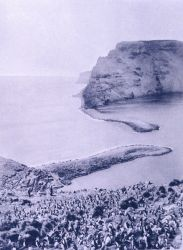 A view of the sand bars at the entrance to the harbor formed by the caldera at St Photo