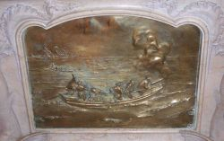 Bronze casting of Prince Albert capturing a pilot whale from a whale boat of the