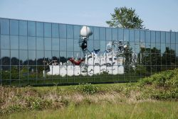 NOAA ship OKEANOS EXPLORER reflected in the glass windows of NOAA's Sand Point facility. Photo