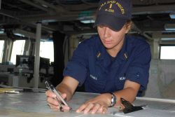 Ensign Schill on bridge checking position of NOAA Ship PISCES. Photo