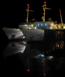 Night view of NOAA Ship FAIRWEATHER tied up outboard of NOAA Ship RAINIER at Petersburg pier. Photo