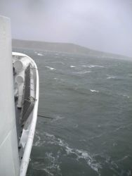NOAA Ship FAIRWEATHER riding out a storm at anchor near Port Clarence. Photo