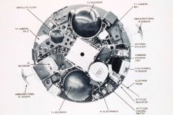 Overhead view of a TIROS satellite showing interior arrangement of satellite sensing packages including TV cameras and infra-red sensors Photo