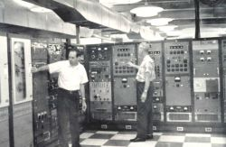 Technicians operating electronic equipment for recording and displaying TIROS television, infrared, and telemetry signals. Photo