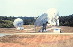 13-meter GOES C antenna in foreground, 11-meter special purpose antenna, and 18-meter GOES B antenna in background. Photo