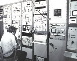 An engineer checking some of the electronics associated with satellite data reception and processing. Photo