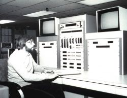 Satellite Operations Control Center (SOCC) Controller James Budd at TIROS-N Controller's console, from which two operational TIROS-N type spacecraft a Photo