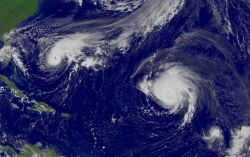 Hurricane Jeanne, Hurricane Karl, and Tropical Storm Lisa are all in view from west to east. Photo