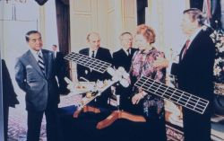 President Ronald Reagan and Prime Minister Margaret Thatcher inspecting satellite model. Photo