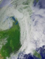A comma-shaped storm system moving over parts of the Midwestern, Southern, and Northeastern United States Image