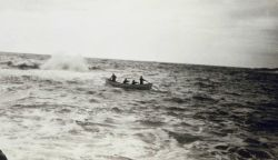 Sounding within surf line with rowed skiff Photo