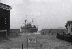 ALBATROSS III breaking loose from pier during hurricane. Image