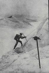 Climbing peak 5300 with survey gear - 141st meridian Photo