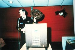 Captain Sig Peterson preparing to make presentation of carved NOAA Corps plaque to Rear Admiral Harley Nygren (out of picture). Photo