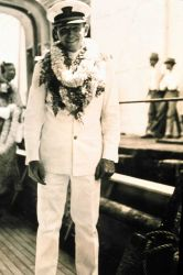Ensign John Ellerbee wearing lei at Honolulu. Photo