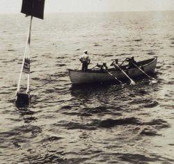 Planting a survey signal buoy Photo