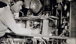 Radio operator at work at Radio Acoustic Ranging shore station KGHS Photo