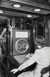 Woman professional operating tide prediction machine Photo