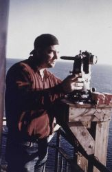Bob Pryce operating Wild T-3 theodolite at Chandeleur Lighthouse Photo