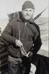 Crewman Alaskin with pet blue fox on shoulder Photo