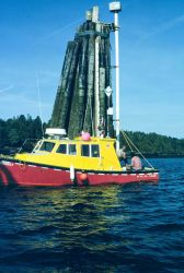 Canadian Hydrographic Service launch checking NOAA tide gauge during international cooperative charting project on Passamaquoddy Bay Photo